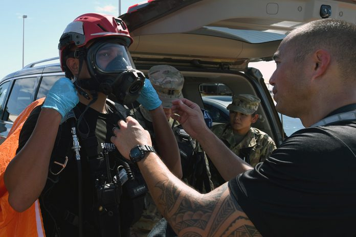 Responder puting on mask for training exercise