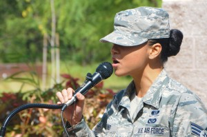Senior Airman Jaime Aquino with the 154th Civil Engineering Squadron, Hawaii Air National Guard, sings the national anthem at a ground breaking ceremony for a solar array facility being built for the HIANG at Joint Base Pearl Harbor-Hickam, Oct. 27, 2015. The solar array facility will be one piece of the HIANG's renewable energy strategy to decrease it's electricity expense and increase it's energy security. (U.S.Air National Guard photo by Senior Airman Orlando Corpuz/Released)