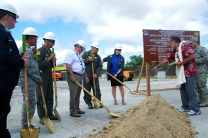 Hawaii Air National Guard officials break ground at the site of a future HIANG solar array farm on Joint Base Pearl Harbor-Hickam, Oct. 27, 2015. The solar array farm will be one piece of the HIANG's renewable energy strategy to decrease it's electricity expense and increase it's energy security. (U.S.Air National Guard photo by Senior Airman Orlando Corpuz/Released)