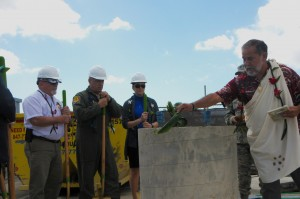 "Officials for the Hawaii Air National Guard look on as Hawaiian ""Kahu"" or priest Roy Brooks performs a traditional Hawaiian blessing on the cornerstone pillar of a future solar array facility being built at Joint Base Pearl Harbor-Hickam, Oct. 27, 2015. The solar array facility will be one piece of the HIANG's renewable energy strategy to decrease it's electricity expense and increase it's energy security. (U.S.Air National Guard photo by Senior Airman Orlando Corpuz/Released)"