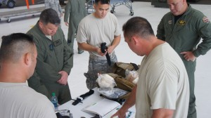 Airmen from the Hawaii Air National Guard familiarize themselves with the contents of a field medics kit during the hands on portion of self-aid and buddy care training during August's unit training assembly, Aug. 9, 2015, Joint Base Pearl Harbor-Hickam. (U.S. Air National Guard Photo by Tech. Sgt. Andrew Jackson)