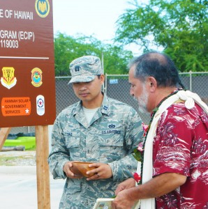 "U.S. Air Force Capt. Nhut Dao with the 154th Civil Engineering Squadron, Hawaii Air National Guard, assists Hawaiian ""Kahu"" or priest Roy Brooks while he performs a blessing at a ground breaking ceremony for a solar array facility being built for the HIANG at Joint Base Pearl Harbor-Hickam, Oct. 27, 2015. The solar array facility will be one piece of the HIANG's renewable energy strategy to decrease it's electricity expense and increase it's energy security. (U.S.Air National Guard photo by Senior Airman Orlando Corpuz/Released)"